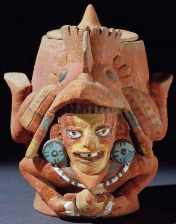 Figure 9: Ceramic diving god container wearing a bird headdress, housed at the U.S. Library of Congress