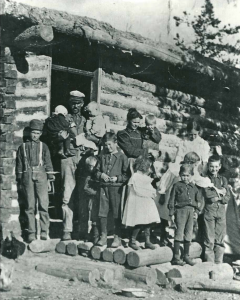 Figure 10. The John Robert and Luna Ardell Paul family at their homestead at Cedron, Idaho, ca. 1899. Two additional girls were born after this picture was taken. Lynn Paul is the small child wearing dark clothes in the right arm of his father.