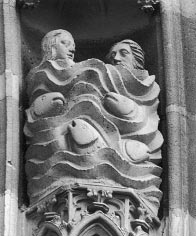 Figure 18. The Penitent Baptism of Adam and Eve. 1340–1351. West façade, detail of the upper tympanum, middle archivolt, Church of St. Théobald, Thann, France.